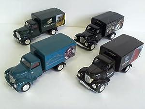 4 LKW: WG-143 mit verschiedenen Werbeaufschriften: Modell-Autos
