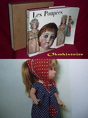 Les poupées. -------- [ Photographies de H. Landschoff. Traduction de Genevieve Wehner. ]: ...