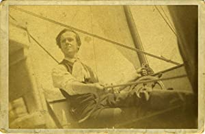 Photograph of a young American man sailing a yacht