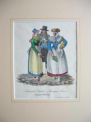 """Sächsische Tracht - Costume Saxon. (Gegend um Dresden)"""". (Gruppe von 2 Frauen u. 1 Mann)...."""