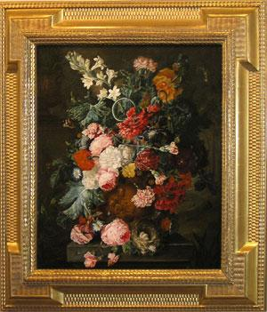 A Still life of summer flowers, roses, carnations, tulips and peonies in a terra cotta figural ur...