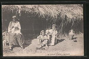 Ansichtskarte Au Gourbi, Nordafrikanerinnen vor Hütte