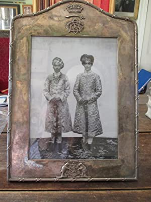 BARODA. A Large Silver Plated Presentation Phtograph Frame, Circa 1920s with Cast Arms of the State
