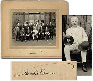 Signed Photograph of Edison holding a Record with the staff of the Edison Disc Plant