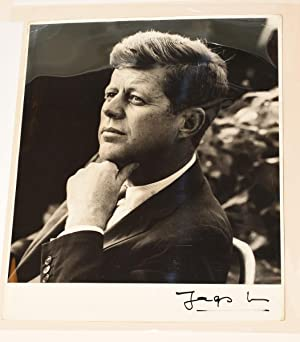 PRESIDENT JOHN F. KENNEDY. TWO PHOTOGRAPHS, SIGNED. | WITH A SIGNED COPY OF LOWE'S BOOK IN ...