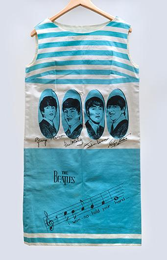 A Beatles dress worn by a programme: THE BEATLES.