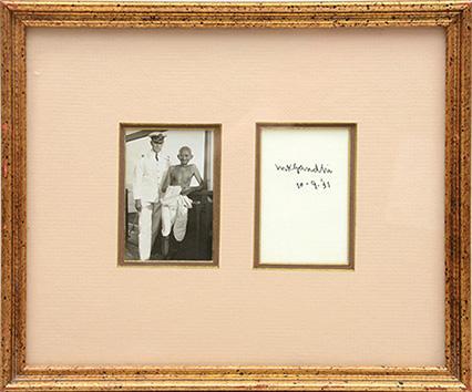 Signed original photograph of Gandhi on board: GANDHI, Mohandas K.,