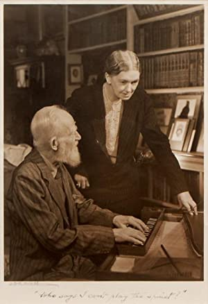 Portrait of Shaw playing the spinet with: SHAW, George Bernard.)