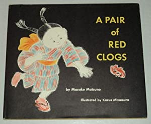 A PAIR OF RED CLOGS.