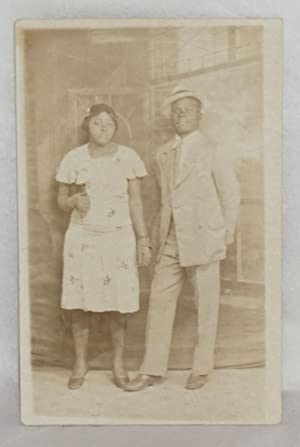Postcard with African American man and woman]