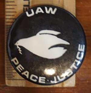 Two anti-war UAW pinback buttons]: United Automobile Workers]