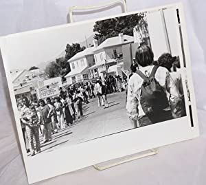 Two photographs of a protest at San Quentin
