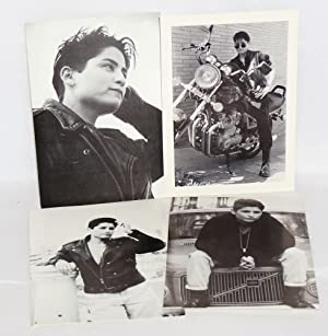 Four b&w photo postcards signed