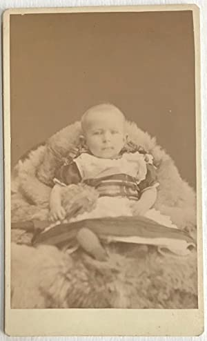 [Photographic card of a European baby, with text on reverse: