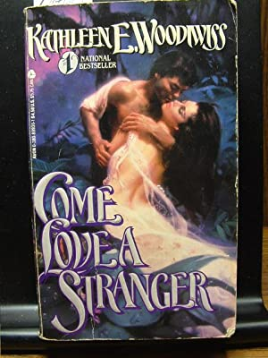 COME LOVE A STRANGER/THE WOLF AND THE: Woodiwiss, Kathleen E.