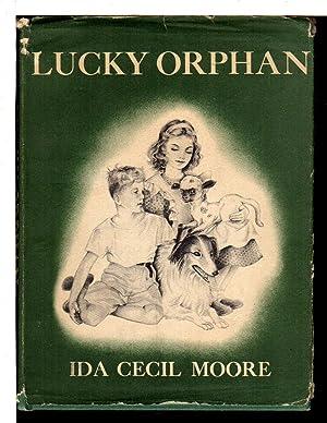 LUCKY ORPHAN.: Moore, Ida Cecil.