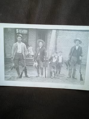 Vintage photograph of duck hunters and game