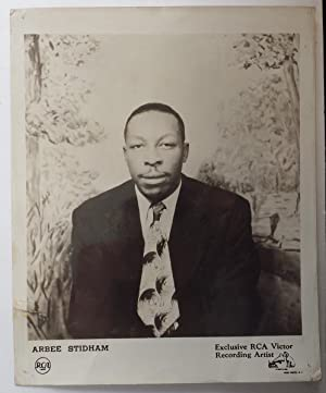 Promotional photograph of blues singer Arbee Stidham ;