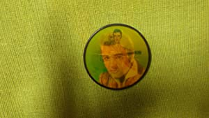 Elvis Presley Round Flashing Pin 1956 with Elvis in striped jacket Holding Guitar
