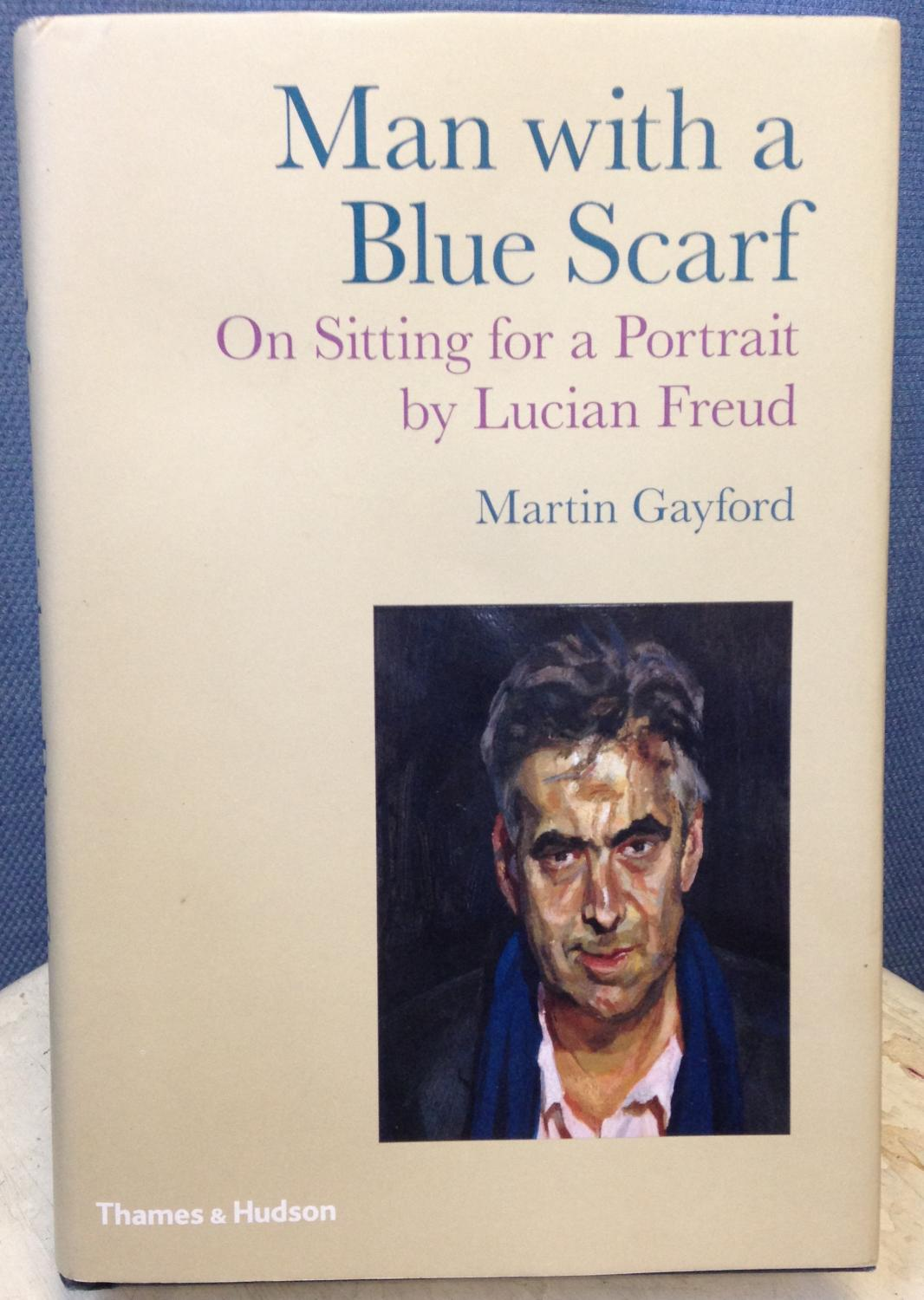 Man with a Blue Scarf On Sitting For A Portrait