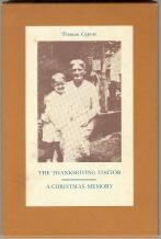 The Thanksgiving Visitor/A Christmas Memory Capote, Truman Near Fine Hardcover Random House, 1967. Larger, thinner book in slipcase, orange cloth spine, red-brown cloth boards with embossed initials at top front, lightly faded at