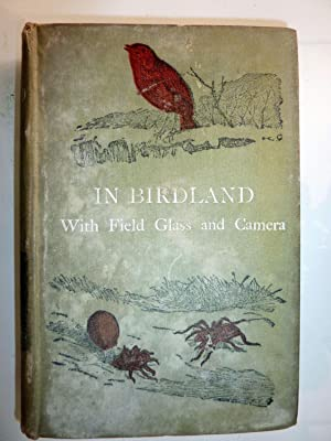 IN BIRD LAND WITH FIELD GLASS AND CAMERA