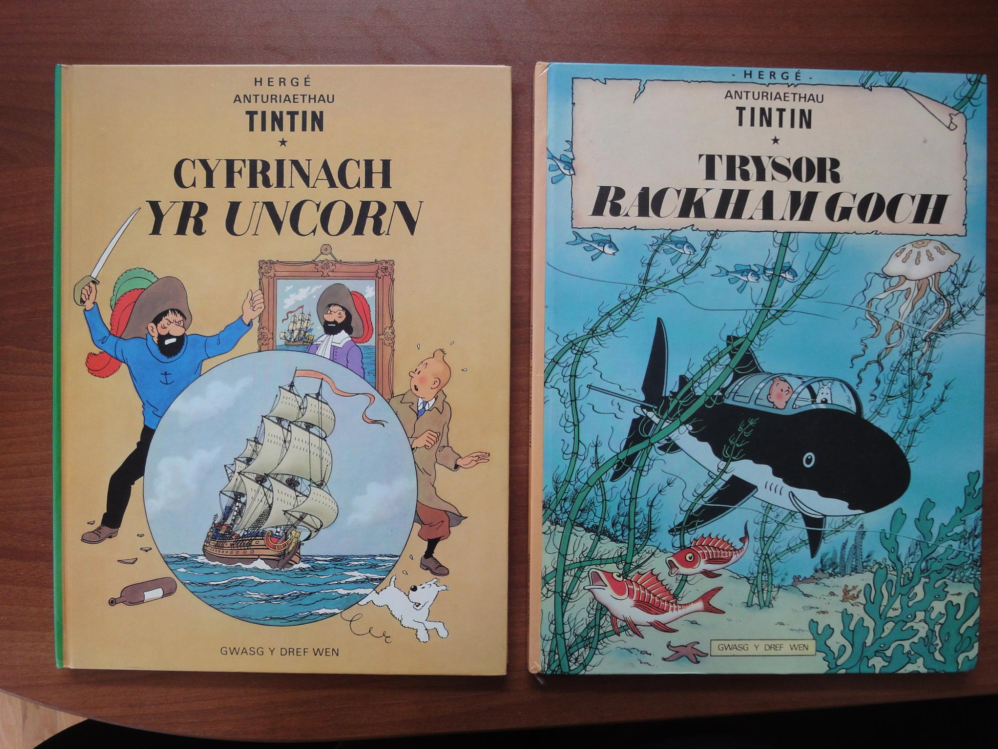 Set of 2 Tintin Books in Welsh (Wales): Cyfrinach Yr Uncorn (The Secret of the Unicorn), Trysor Rackham Goch (Red Rackham's Treasure) [Tintin Foreign