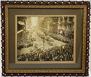 [WORLD WAR I] [CLEVELAND] Framed photograph of World War I Army trucks driving down Cleveland's E...