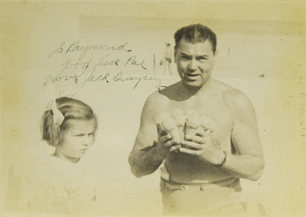 Autographed_photo_of_Jack_with_8_ice_cream_cones_in_hand_at_the_beach_in_swim_suit_with_little_girl_at_his_side_Dempsey,_Jack_[_]