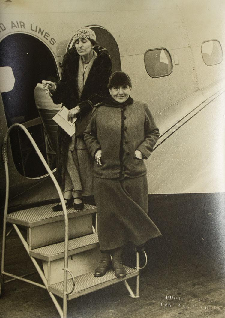 Portrait photograph of Gertrude Stein and Alice B. Toklas boarding a United Airlines plane (Stein, Gertrude & Alice B. TOKLAS) Van Vechten, Carl Fine