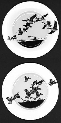 A Set of Eight China Dinner Plates: Hunt, Lynn Bogue)