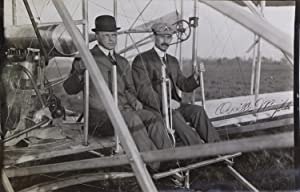 Photograph of Orville Wright with Major Albert B. Lambert seated in the Wright Flyer, 1910, signe...