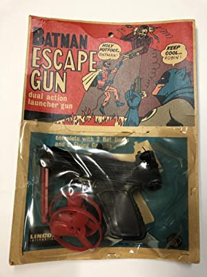 Batman Escape Gun 1966- complete in packaging bubble torn