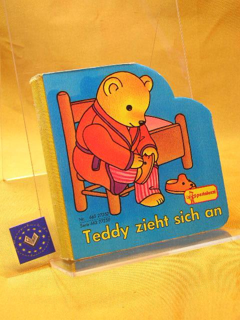 Teddy zieht sich an.