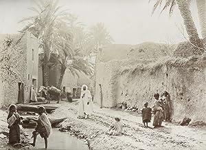 Children playing, Village view.: BISKRA.