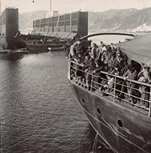 Deckpassengers on the SS Angara. In the background the pier and dock.: BAIKAL LAKE.