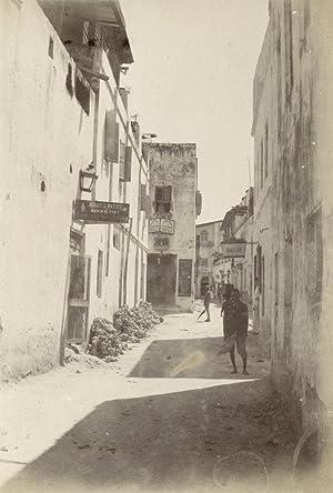 View in street with some shops.: ZANZIBAR.