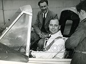 Portrait of R. J. Falk and F. Bassett, pilot and engineer repectively, in the cockpit of an Avro ...