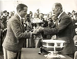 The Secretary of State for Air, Sir Philip Cunliffe-Lister presenting the King's Cup to Mr. ...