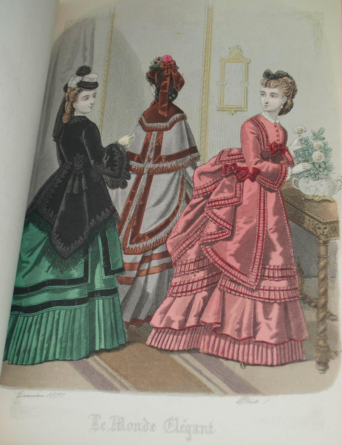 Coloured Plates of the Ladies Fashion COSTUME Softcover 564 Hand Coloured Plates Illustrating Ladies Fashion From 1871-1877 [COSTUME]. Coloured Plates of the Ladies Fashion. London & Paris: [1871-78]. Three