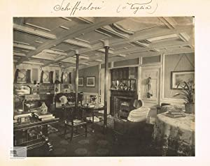 Interior View of the saloon and library with many books, maps and nautical instruments on board o...