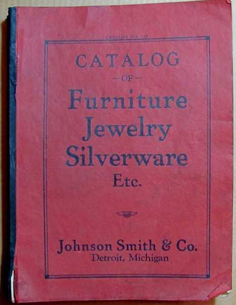 Johnson Smith & Co. Catalog of Furniture Jewelry Silverware Etc. Catalog No. 152 Johnson Smith & Co. [Moyen] [Couverture souple] Size: 4to. Text body is clean, and free from previous owner annotation, underlining and highlighting. Binding is sound. No date but circa 1938 or 1939. Red stiff card wraps with a black cloth tape spine, a catalog for Johnson Smith & Co. ( Only Concern of Its Kind in America ), fully illustrated in color and black-and-white with prices, 676 pages, Index. This catalog is quite worn, covers and text block edges soiled, corners creased, one-inch separation at base of spine at front cover, first page soiled (a few pages near the front of the catalog also soiled at edges & corners), some pages have creases at corners. Interior pages are remarkably clean and binding is sound. According to their website,  Johnson Smith Company, [is] one of the oldest catalog companies in the United States.A household name in novelties, gifts and collectibles since 1914.  This company sold just about everything: custom made to measure suits, shoes, cigarettes, Philco radios, automobile tires and batteries, lighters, toasters, cocktail sets, toys, trains, pedal cars, bicycles, dolls, rifles, fishing rods, guitars, golf and baseball equipment, furniture, home decoration, raincoats and umbrellas, rugs, smoking stands, cribs, baby carriages, Napanee portable kitchen units, steel cabinets for the kitchen, Chromsteel kitchen tables and chairs, ranges, ice refrigerators, violins, and other musical instruments, sporting equipment, fountain pens, sterling silver tableware,movie cameras and equipment, microscopes, binoculars, jewelry, clocks, watches and pocket watches, birds, luggage, backyard swing sets, and a whole lot more. Quantity Available: 1. Shipped Weight: 6 lbs 0 oz. Category: Engineering, Industrial, Trade; Picture 2: Waltham watches; note the railroad pocketwatch. Picture 5: First page. Pictures of this item not already displayed here available upon request. In