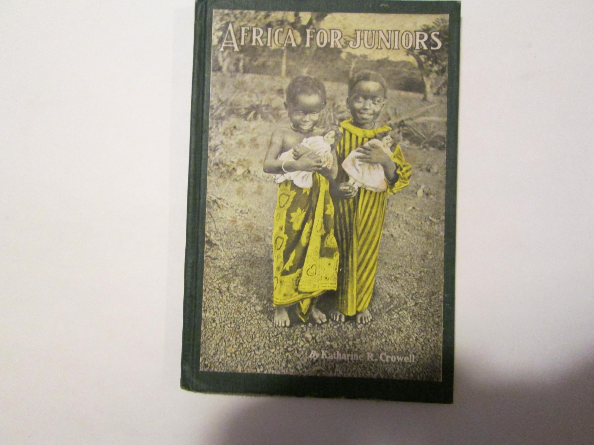 AFRICA FOR JUNIORS Crowell, Katharine 86p, illustrated w photos of African life. Charming paste-on cover photo of two little Black girls in African dress, each holding a white doll. Rare.