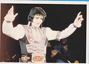 ELVIS PRESLEY IN PERFORMANCE AT A CONCERT IN NASSAU JULY 1975. MAGNA BOOKS. REDFERNS. STEVE MORLE...