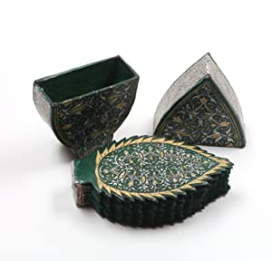 A miniature leaf-shaped Qur'an, copied by Mohammad: Quran.