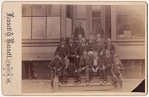 Lewiston, Me. Boys and Men Posing on Storefront cabinet card