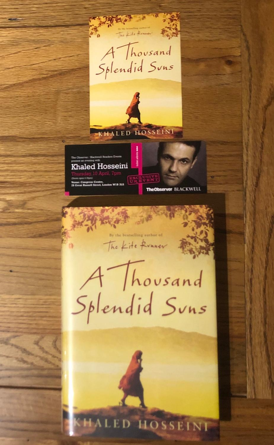 A Thousand Splendid Suns Hosseini, Khaled [ ] [Hardcover] First UK Edition. Publisher's maroon boards with gilt lettering on the spine. A VERY FINE DOUBLE-SIGNED FIRST UK FIRST EDITION WITH THE AUTHOR'S UNHCR FLYER AND SEPARATE SIGNING EVENT PHOTOGRAPH LAID IN. A very fine copy in like D/W with the scarce, red, wrap-around band. Original price of £12.99 on the inside flap. Blue end-papers and red ribbon page-marker. Signed by the Author in both English and Farsi on the title page. Scarce with these attributes. Photographs/scans available upon request.