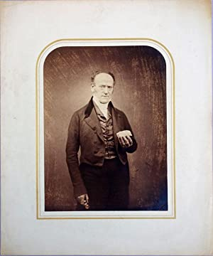 Sepia-toned portrait photograph by Maull & Polyblank: Robert E Grant