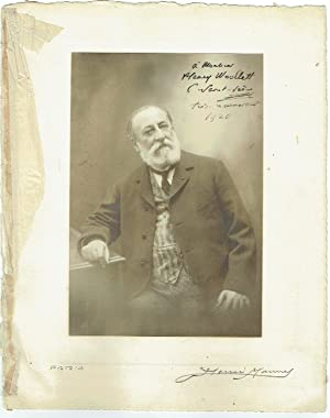 Signed and inscribed portrait photograph.