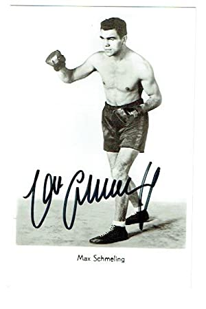 Signed 3.5 x 5.5 photograph of Schmeling standing in full length boxing action pose.